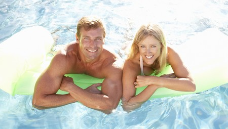 Couple Outside Relaxing In Swimming Pool photo