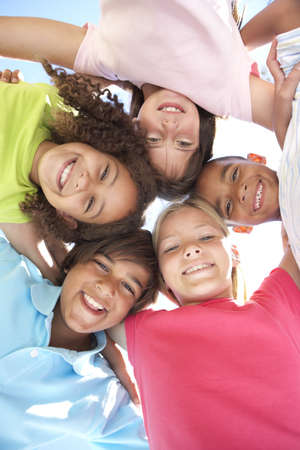 child looking up: Group Of Children Looking Down Into Camera