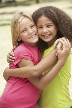 9 year old girl: Two Girls In Park Giving Each Other Hug