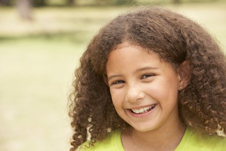 9 year old girl: Portrait Of Happy Young Girl In Park