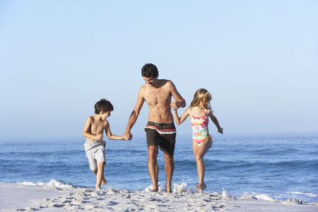 5 year old: Father Running With Children Along Sandy Beach