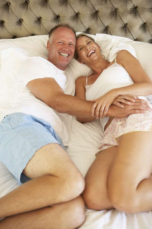 Couple Relaxing In Bedroom photo