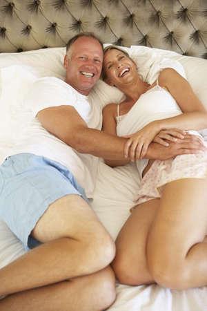 Couple Relaxing In Bedroom photo
