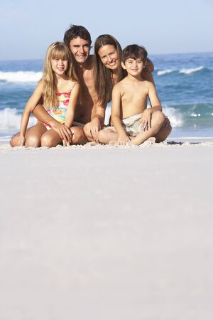 Young Family Relaxing On Beach Holiday Stock Photo - 8482943