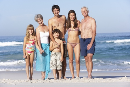 Three Generation Family On Holiday Walking Along Beach Stock Photo - 8483297