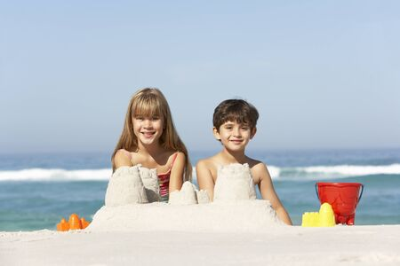 7 year old girl: Children Building Sandcastles On Beach Holiday