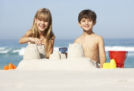 Children Building Sandcastles On Beach Holiday Stock Photo - 8482799