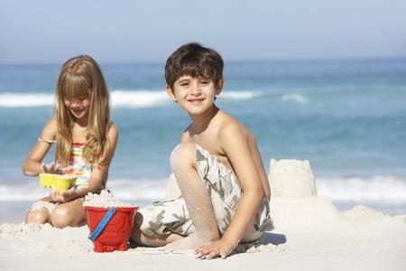 Children Building Sandcastles On Beach Holiday photo