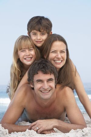 Young Family Having Fun On Beach Holiday photo