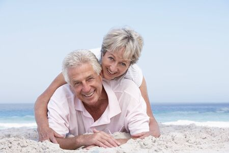 Senior Couple Relaxing On Beach Holiday photo