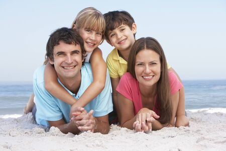 Family Relaxing On Beach Holiday Stock Photo - 8483222