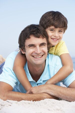 Father And Son Relaxing On Beach Holiday Stock Photo - 8483147