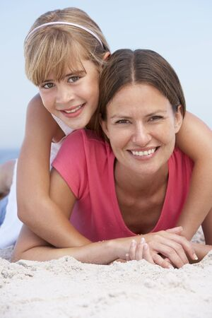 Mother And Daughter Relaxing On Beach Holiday Stock Photo - 8483149