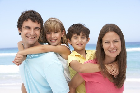 Family Having Piggyback Fun On Beach Holiday Stock Photo - 8483220
