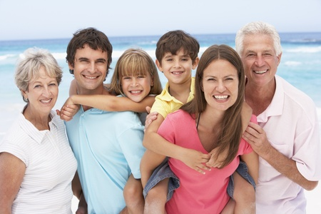 Three Generation Family Relaxing On Beach Holiday Stock Photo - 8483078