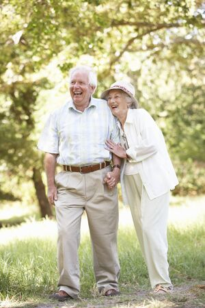 Senior Couple Walking In Park Stock Photo - 8483289