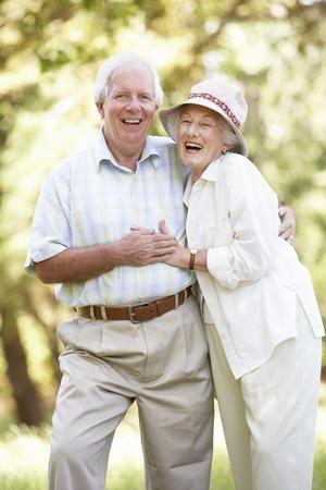 Senior Couple Walking In Park photo