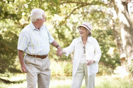 healthy seniors: Senior Couple Walking In Park