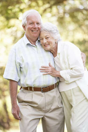 Senior Couple Walking In Park photo