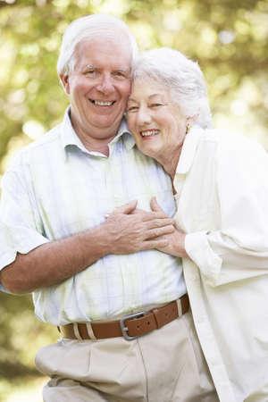 Senior Couple Walking In Park Stock Photo - 8483260