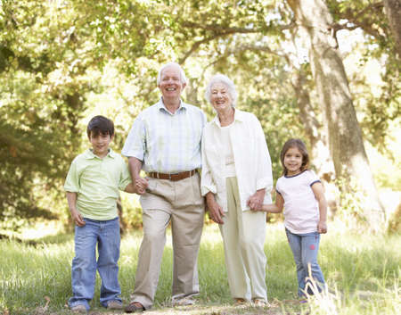 Grandparents In Park With Grandchildren Stock Photo - 8483250