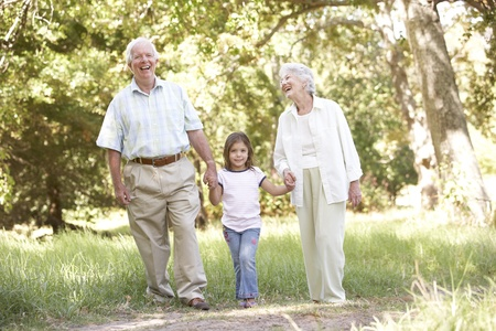 Grandparents In Park With Granddaughter photo