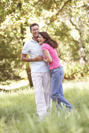 Portrait Of Young Couple Walking In Park Stock Photo - 8483311