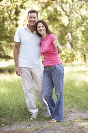 Portrait Of Young Couple Walking In Park Stock Photo - 8483349
