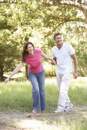 Portrait Of Young Couple Walking In Park photo