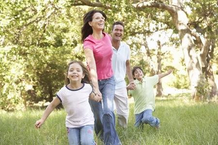 Family Enjoying Walk In Park Stock Photo - 8483328