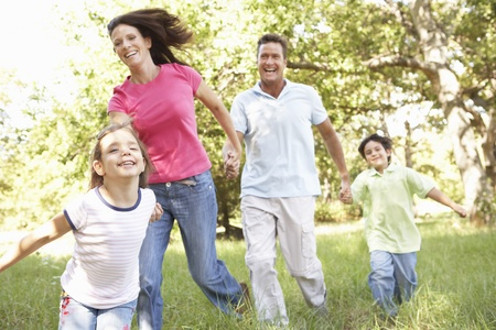 healthy person: Family Enjoying Walk In Park