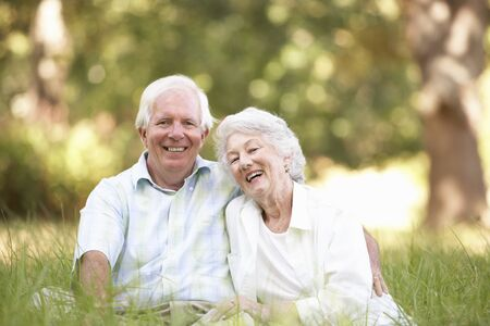 Senior Couple Sitting In Park photo