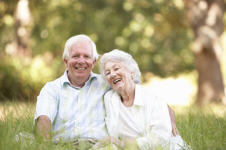 Senior Couple Sitting In Park Stock Photo - 8483262