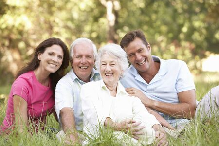 grown up: Senior Couple With Grown Up Children In Park