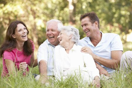 Senior Couple With Grown Up Children In Park photo