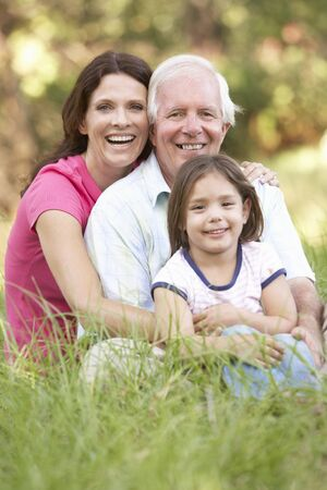 Grandfather With Daughter And Granddaughter In Park Stock Photo - 8483285