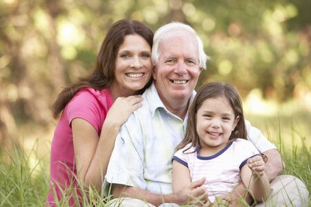 Grandfather With Daughter And Granddaughter In Park Stock Photo - 8483277