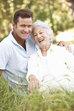 Senior Woman With Adult Son In Garden Stock Photo - 8483291