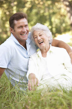 Senior Woman With Adult Son In Garden photo
