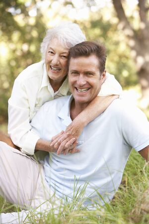 40s adult: Senior Woman With Adult Son In Garden Stock Photo