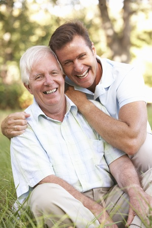father and son: Senior Man With Adult Son In Garden Stock Photo