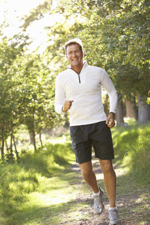 Middle Aged Man Jogging In Park Stock Photo - 8488333