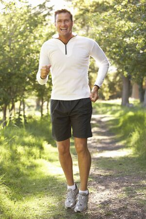Middle Aged Man Jogging In Park Stock Photo - 8488334