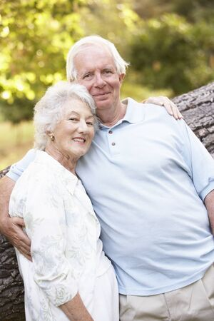 Senior Couple Walking In Park Stock Photo - 8483348