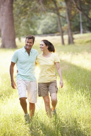 Portrait Of Young Couple Walking In Park Stock Photo - 8483353