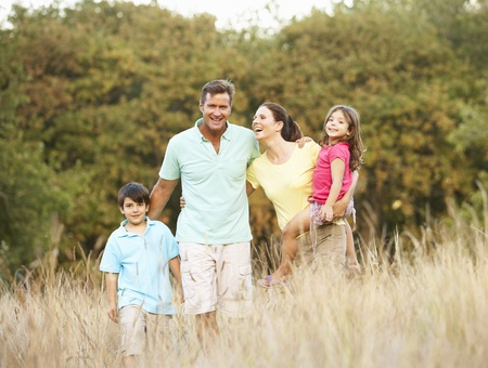 Family Enjoying Walk In Park photo