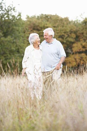 Senior Couple Walking In Park Stock Photo - 8483168