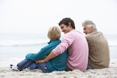 grandson: Grandfather, Father And Grandson Sitting On Winter Beach Stock Photo