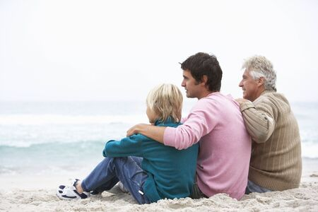 Grandfather, Father And Grandson Sitting On Winter Beach Stock Photo - 8483229