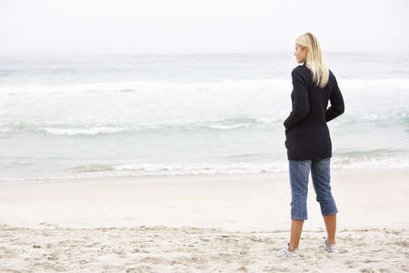 Young Woman On Holiday Standing On Winter Beach Stock Photo - 8483066